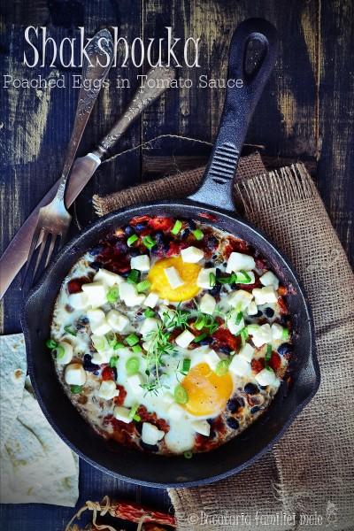 Shakshouka – Baked Eggs in Tomatoes with Black Beans and Feta