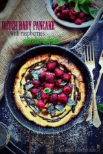 Dutch baby pancake with raspberries, chocolate and mint